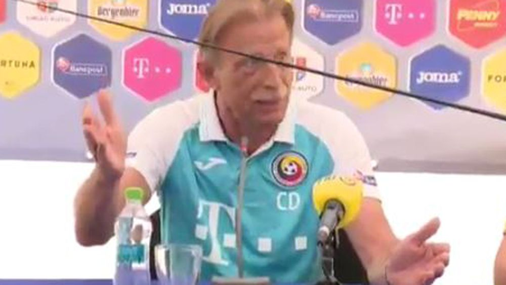 Romania football coach Christoph Daum fuming at journalist's fishing rod stunt at press conference