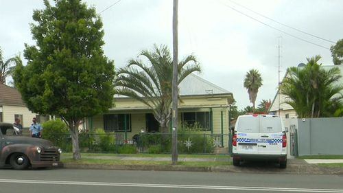 A man has been arrested and is assisting police after the body of a 76-year-old woman was found in the yard of a home near Wollongong, south of Sydney.
