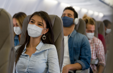 People wearing face masks on plane