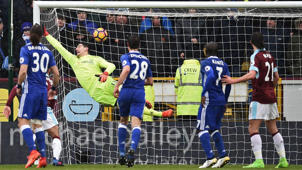 Chelsea's goalkeeper Thibaut Courtois cannot prevent Robbie Brady's freekick in their draw against Burnley. (AFP)