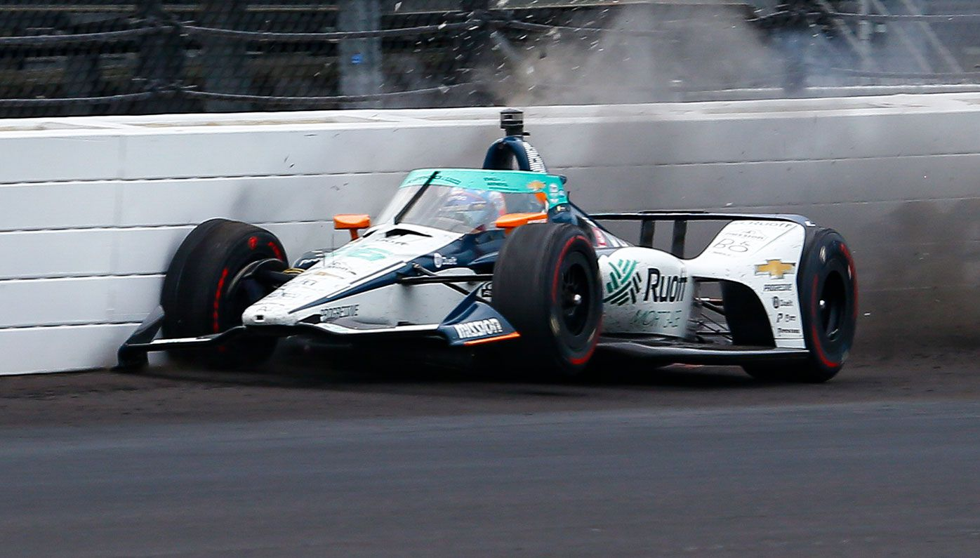 Fernando Alonso hits the wall during practice for the Indy500.