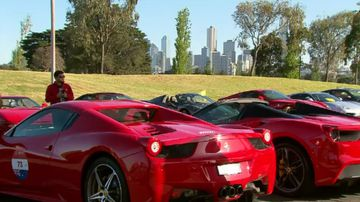 Ferrari owners paint Melbourne red for luxury car's birthday