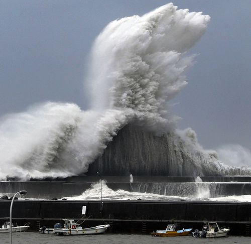 High waves hit breakwaters at a port of Aki.