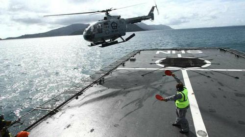 An Indonesian Navy helicopter assists in the search for missing AirAsia flight QZ8501 near Batam, south of Singapore. (AP)