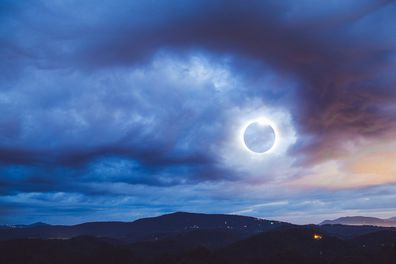 The Totality Solar Eclipse a double exposed image shot with the Blue Ridge Mountains in North Carolina.