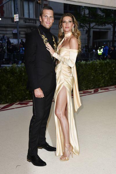 Supermodel Gisele Bündchen in Versace and football quarterback husband Tom Brady