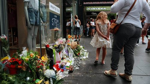 Flowers were laid outside City Life hotel in Auckland's CBD after Grace's death.