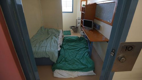 "A cell that was originally built for one seen repurposed for ""double-up"" prisoners, due to overcrowding, at the Brisbane Women's Correctional Centre in Queensland. Difficult conditions of confinement can be particularly problematic for people with disabilities. (Image: AAP)"