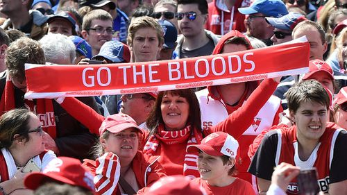 A diehard Swans fan at the AFL Grand Final parade yesterday. (AAP)