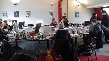 The remaining staff of Charlie Hebdo, in the Liberation offices, where they've been working since the massacre.
