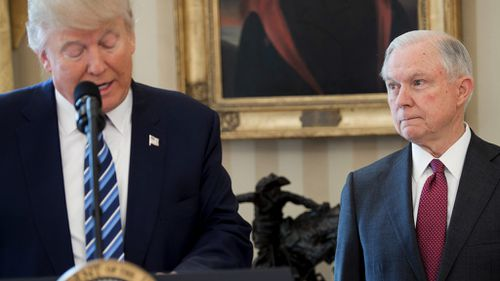 US President Donald Trump speaks alongside US Attorney General Jeff Sessions after Mr Sessions was sworn in as Attorney General in the Oval Office on February 9, 2017. (AFP)