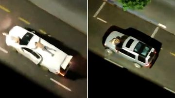 Hostages are strapped to the roofs and bonnets of getaway cars during the robbery in Brazil.