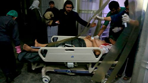 A man injured in a suicide bombing is brought into a hospital for treatment in Kabul, Afghanistan.
