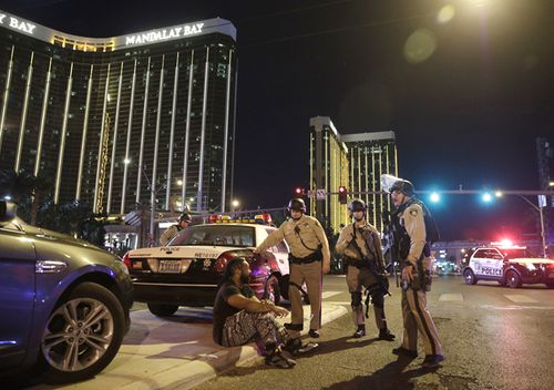 Police officers stand at the scene of a shooting near the Mandalay Bay resort and casino on the Las Vegas Strip. (AP)