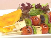 Char-grilled vegetable and haloumi skewers with polenta cakes
