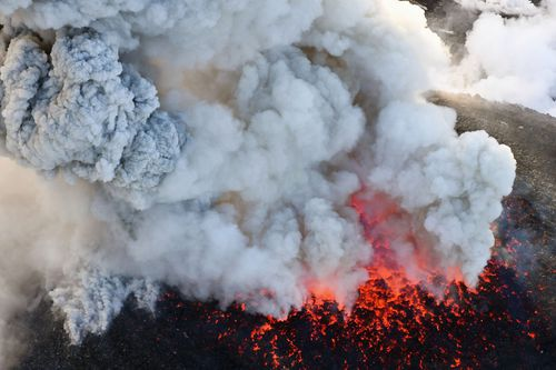 The volcano erupted violently several times, shooting up ash and smoke up to 2,300 metres. (AP)