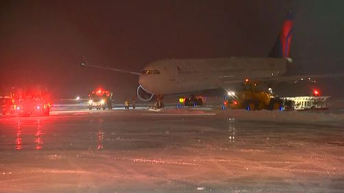 Plane carrying NFL team slides off taxiway