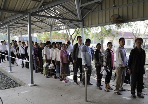 Cambodian villagers lined up on the streets to enter the court and hear the guilty verdict over 1.7 million deaths.
