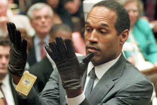 O.J. Simpson tries on the gloves in court. (AAP)