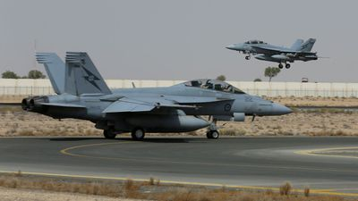 """<b _tmplitem=""""1"""">Photos from Australia's military operation in Iraq:</b> The two Super Hornets departing Australia's main base in the Middle East to conduct their first combat mission in Iraq in October. (Picture: ADF)"""