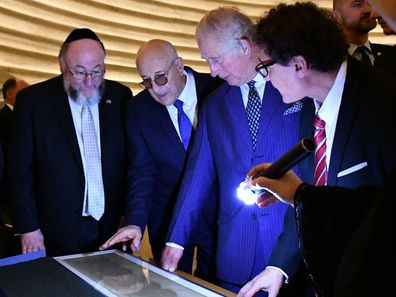 The Prince of Wales hears about the Shrine of the Book exhibition which houses the Dead Sea Scrolls, the world's oldest biblical manuscripts. HRH had the opportunity to view the scrolls inside the Shrine of the Book.