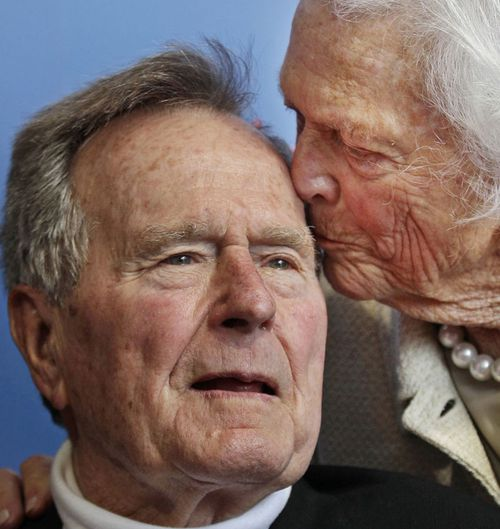 Former President George H.W. Bush, and his wife, former first lady Barbara Bush, arrive for the premiere of HBO's new documentary on his life near the family compound in Kennebunkport, Maine in 2012 Bush has died at age 94.