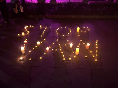 Tea candles were used to spell out STOP VAW (stop violence against women).