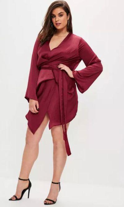 """<a href=""""https://www.missguidedau.com/plus-size-burgundy-satin-kimono-tie-dress-10064409"""" target=""""_blank"""">Misguided Plus Size Burgundy Satin Kimono Tie Dress, $72.95.</a>"""