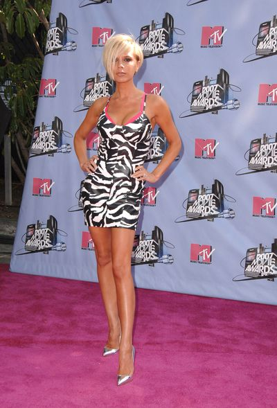 Never forget. Victoria Beckham in a Michael Hobanzebra-print dress at the 2007 MTV Awards in Los Angeles