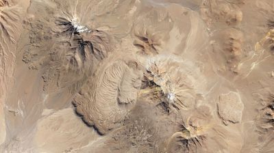 Between these two volcanoes in northern Chile is the Chao dacite, which is a type of lava dome with characteristic ripples that form when exceptionally thick, sticky lava flows onto a steep surface.