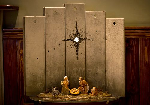 """A new artwork dubbed """"Scar of Bethlehem"""" by the artist Banksy is displayed in The Walled Off Hotel, in the West Bank city of Bethlehem"""