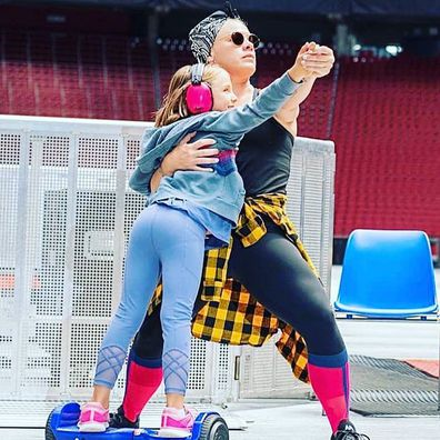 Pink poses with her daughter Willow during her tour.