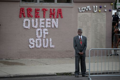 Buildings were decorated with tributes dedicated to Franklin as the hearse passed through the city.