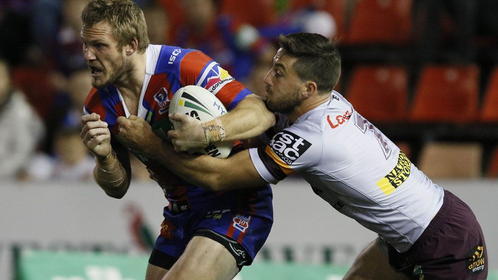 Knights fullback Nathan Ross take on the Brisbane defence. (AAP)