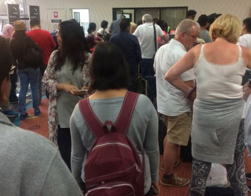 Passengers line up for hotel reservations in Alice Springs. (Donna Edwards)