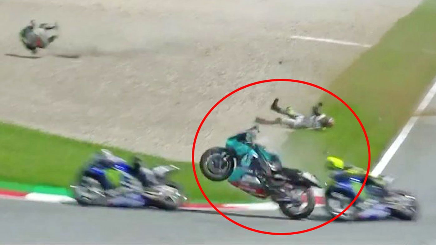 Valentino Rossi narrowly escaped being wiped out side-on by a flying bike