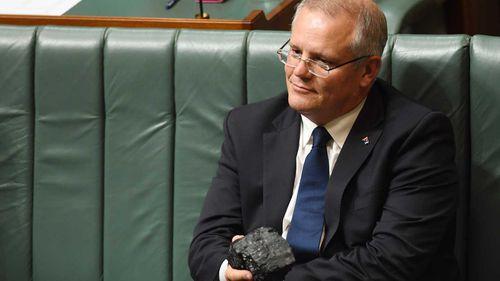 Scott Morrison wields a lump of coal in Parliament.