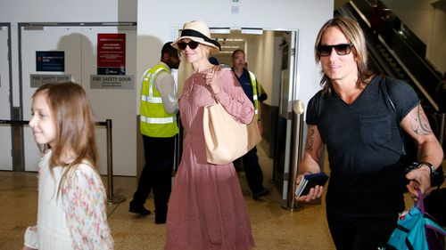 The Aussie actress and her country singer husband arrived at Sydney International Airport today, alongside daughters Faith Margaret, six, and Sunday Rose, nine. (Matrix Media Group)