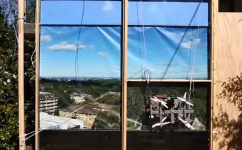 Oliver Nicholls' robotic window cleaner is powered by drones and motors. (Photo: CSIRO).