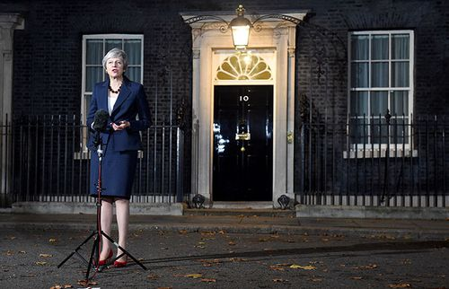 UK Prime Minister Theresa May announces outside 10 Downing Street that she has the support of her cabinet for Britain's Brexit deal with the EU.