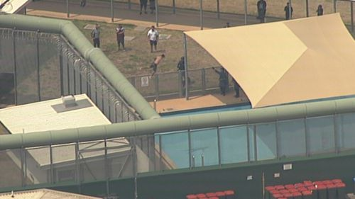 One of the inmates jumped from the roof into a swimming pool.