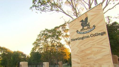 A teacher from prestigious Newington College is facing charges of sharing child exploitation material.
