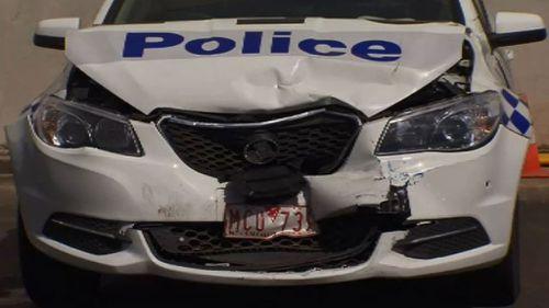 Police car rammed overnight. (9NEWS)