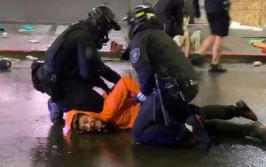 Seattle police officer filmed pushing knee down on protester's neck