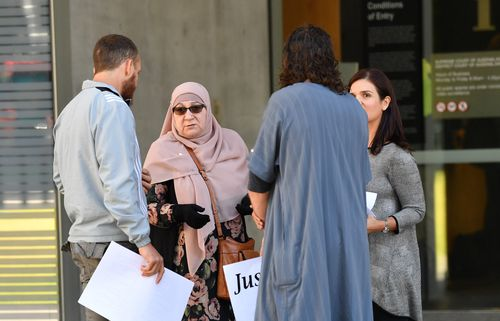 Supporters of Agim Kruezi are seen outside the Brisbane Supreme Court in Brisbane yesterday. Picture: AAP