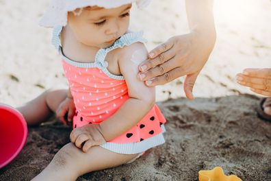 Baby at the beach. baby with sunscreen.