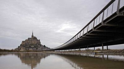 The Mont Saint-Michel access bridge, pictured here in December, is the island's only link to the mainland.