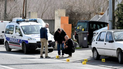 Three people are dead after a gunman took hostages at the supermarket. (AP/AAP)