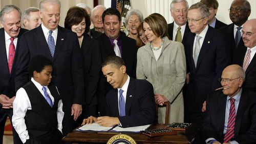 President Obama signs the landmark legislative achievement of his presidency, the Affordable Care Act, soon to be rebranded as Obamacare. The contentious health care law proved a millstone around Democrats' necks in midterm elections in 2010, giving the Republicans a solid majority in the House of Representatives. The conservative opposition managed to block most of Obama's agenda for the rest of his presidency. (AP)