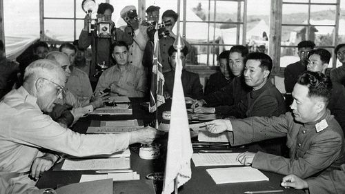 US and North Korean generals sign the 1953 peace armistice at Panmunjom. (AP).